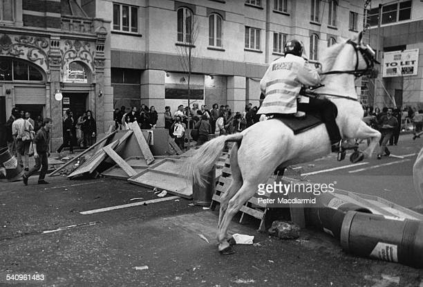 Mounted police on Upper St Martin's Lane during the Poll Tax Riots in London 31st March 1990