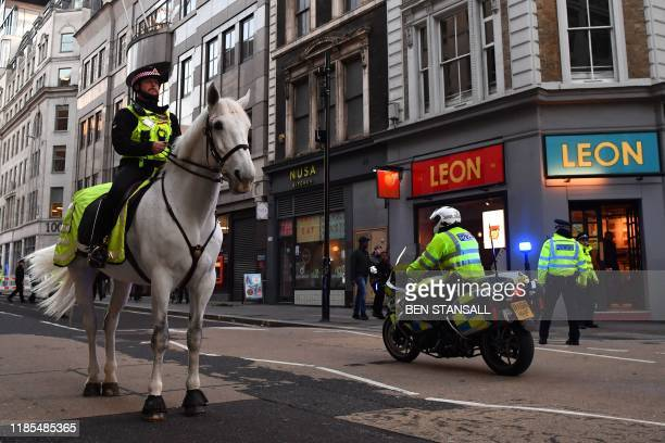 Mounted police patrol along Cannon Street in central London on November 29 2019 after reports of shots being fired on London Bridge The Metropolitan...