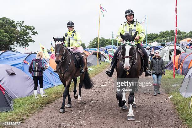 Mounted Police patrol amongst the tents at the Glastonbury Festival at Worthy Farm Pilton on June 28 2015 in Glastonbury England Now its 45th year...