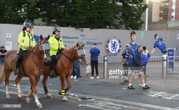 Mounted police patrol as Chelsea supporters gather near Stamford Bridge stadium in the build-up to the UEFA Champions League final football match...