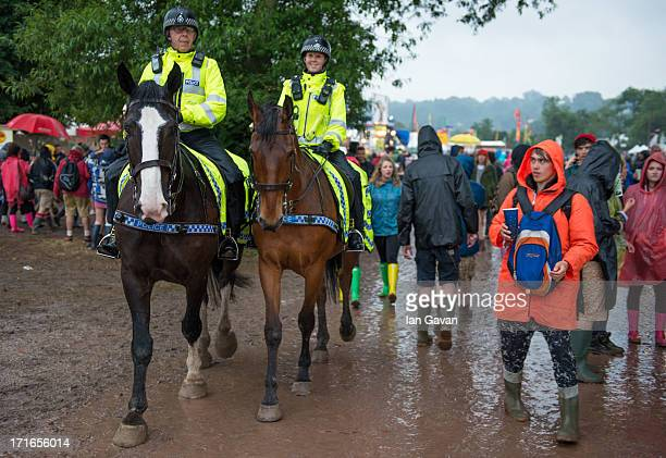 Mounted Police patrol as rain falls during day 1 of the 2013 Glastonbury Festival at Worthy Farm on June 27 2013 in Glastonbury England