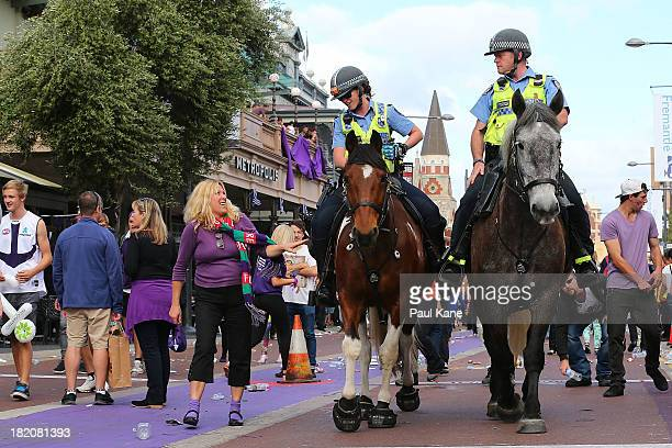 Mounted Police patrol South Terrace as crowds disperse after the 2013 AFL Grand Final between the Hawthorn Hawks and the Fremantle Dockers on South...