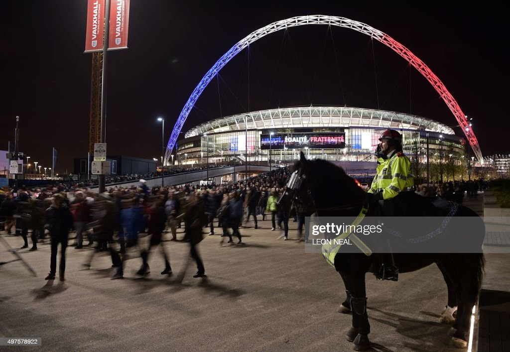 Mounted police personnel keep watch as football fans leave Wembley Stadium following the friendly football match between England and France at Wembley Stadium in west London on November 17, 2015. AFP PHOTO / LEON NEAL