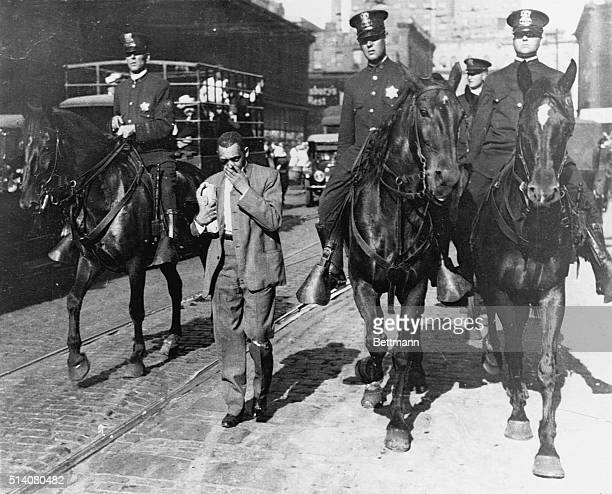 Mounted police round up African Americans and escort them to a safety zone during the Chicago Race Riot of 1919.