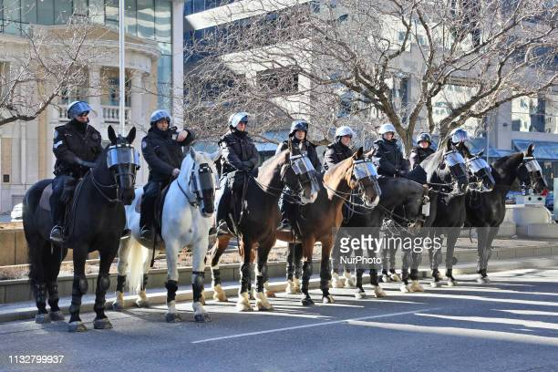 Mounted police stand by as groups of protestors clash during a ProMuslim and AntiMuslim rally held in Toronto Ontario Canada on March 23 2019 Counter...