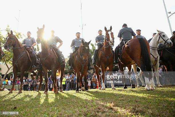 Mounted police stand guard as they wait for the arrival of the Japan team bus for a Japan training session held at Walter Riberio Stadium on June 8...