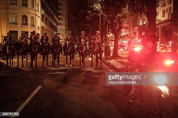 Mounted police stand guard during a demonstration against new Brazilian President Michel Temer in Rio de Janeiro Brazil on September 2 two days after...