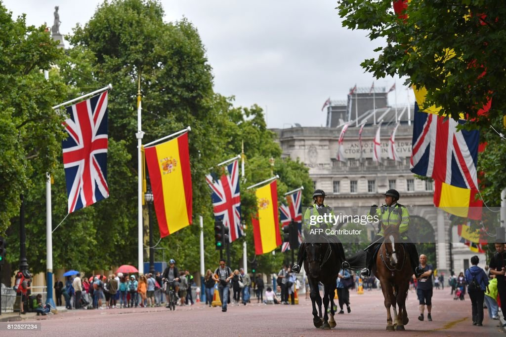 Mounted police walk beneath British Union flags and Spanish flags flying together on the Mall in central London, on July 11, 2017, ahead of the state visit of Spanish King Felipe VI and Queen Letizia. Spanish King Felipe VI and Queen Letizia begin a state visit to Britain on Wednesday, as the two countries attempt to strengthen ties despite tensions over Britain's plans to leave the European Union. /