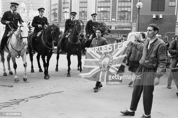 Mounted police watching over Leeds United FC fans from Worcester at Victoria London UK 29th February 1984