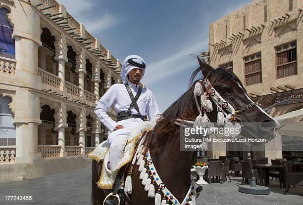 Mounted policeman on an Arabian horses in Old Doha, Qatar