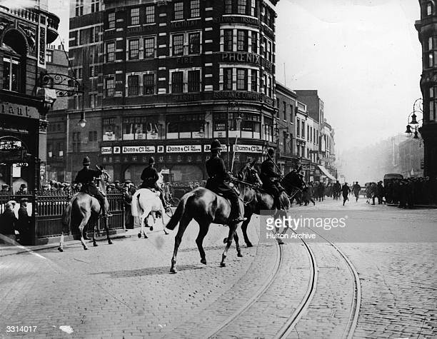 Mounted policemen armed with batons clearing the road after a riotous outbreak at the Elephant and Castle London during the General Strike