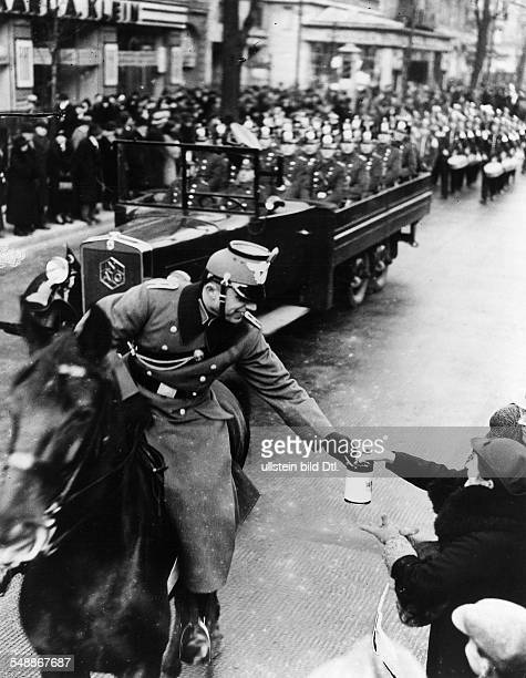 Mounted policemen collection donations during a police parade at the Kurfuerstendamm in Berlin Photographer Heinz Fremke Published by 'Berliner...