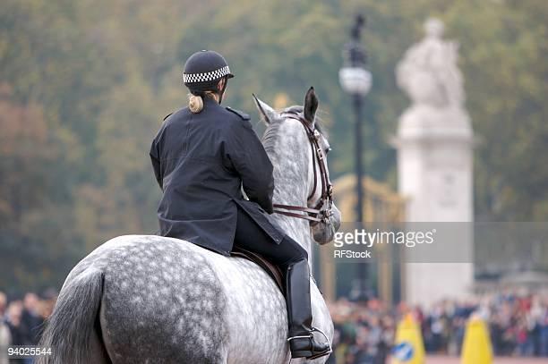 Mounted policewoman outside Buckingham Palace