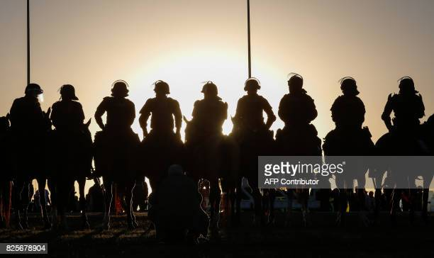 TOPSHOT Mounted riot police stand by around the National Congress where security was reinforced due to a protest against President Michel Temer in...