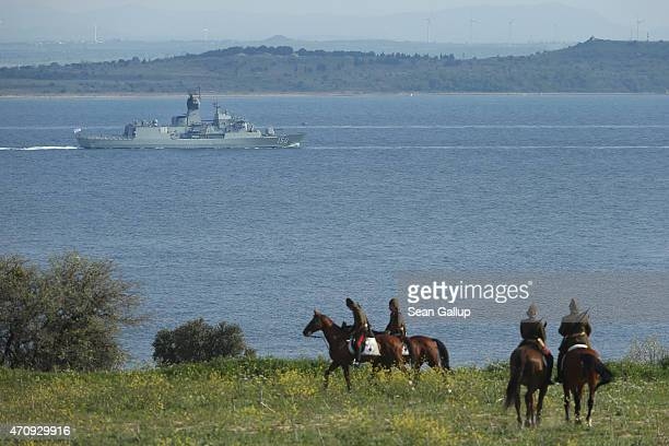 Mounted Turkish gendarmes dressed as World War I Ottoman Turkish soldiers ride horses near the Helles Memorial, which commemorates Commonwealth...