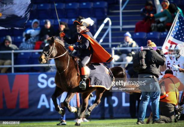 Mounted Virginia Cavalier leads the team into the stadium before the Military Bowl football game between Navy and Virginia at Navy Marine Corps...