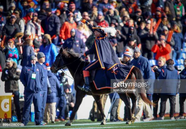 Mounted Virginia Cavalier salutes the crowd before the Military Bowl football game between Navy and Virginia at Navy Marine Corps Memorial Stadium in...