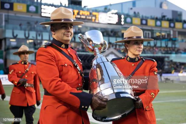 Mounties bring in the Grey Cup before the game between the Calgary Stampeders and the Ottawa Redblacks during the Grey Cup at Commonwealth Stadium on...