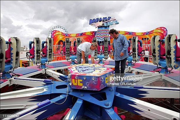 Mounting fairground ride in Lille France on August 25th 2005 A controller of the Center for Mot Rides monitors compliance of the assembly and...