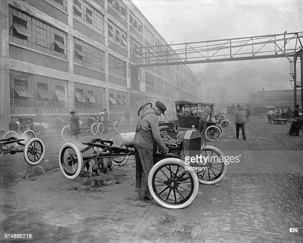 Mounting Ford car at the Ford Motor Plant Photo ca 1913