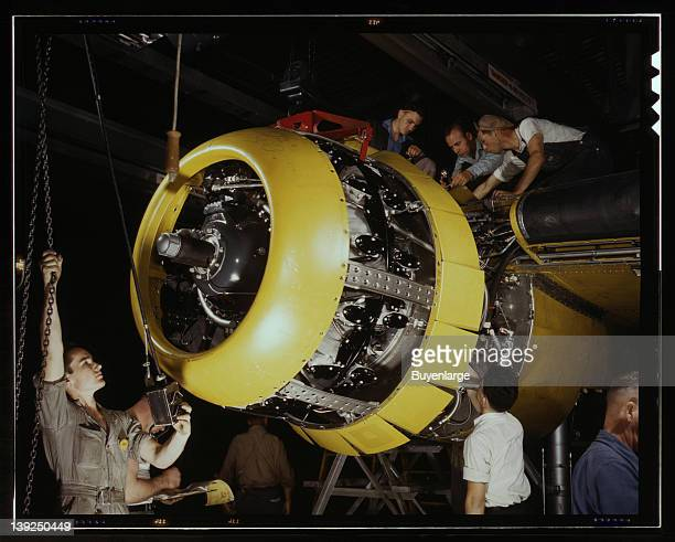 Mounting motor on a Fairfax B25 bomber at North American Aviation Inc plant in Inglewood California 1942
