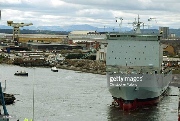 Mounts Bay a newly constructed landing craft for the Royal Fleet Auxiliary slides down the slipway into the waters of the Clyde April 9 2004 at the...
