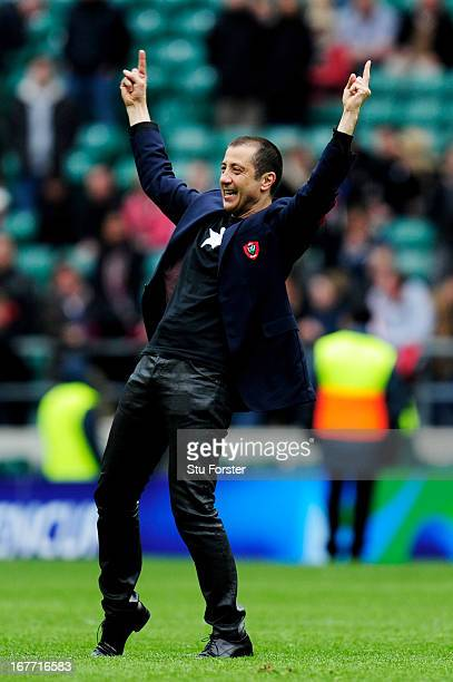 Mourad Boudjellal the owner of Toulon rugby club celebrates following his team's 24-12 victory during the Heineken Cup semi final between Saracens...