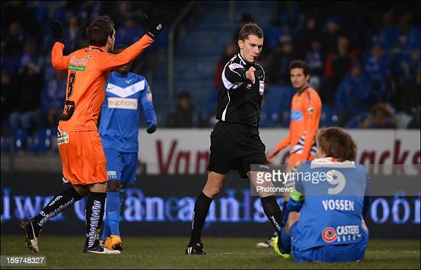 Mourad Satli of Charleroi and Jelle Vossen of Genk listen to a call from Referee Jonathan Lardot during the Jupiler League match between KRC Genk and...