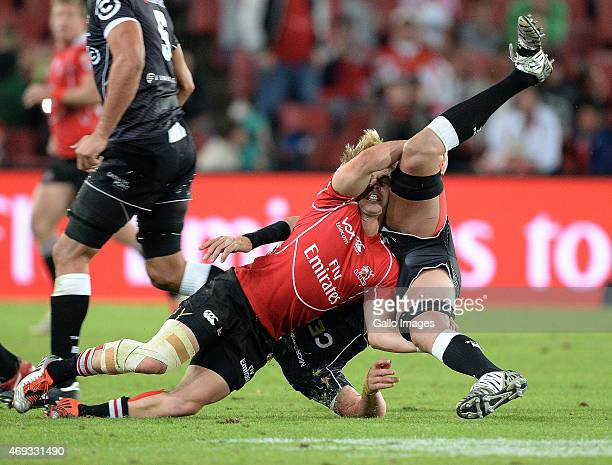 Mouritz Botha of the Sharks gets tackled by Faf de Klerk of the Lions during the Super Rugby Round 9 match between Emirates Lions and Cell C Sharks...