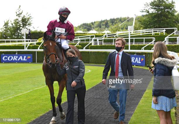 Mouriyani and Tom Marquand in the winners enclosure after the Coral Customers Stream UK Racing Free Handicap at Goodwood Racecourse on June 14 2020...