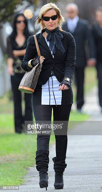 Mourner arrives for the funeral service of slain gangland killer Carl Williams, in Melbourne on April 30, 2010. Carl Williams was bashed to death in...