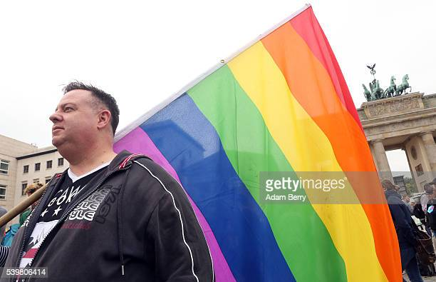 A mourner attends a vigil for victims of a shooting at a gay nightclub in Orlando Florida the previous day in front of the United States embassy on...