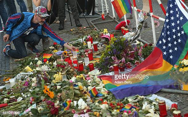 A mourner attends a vigil for victims of a shooting at a gay nightclub in Orlando Florida nearly a week earlier in front of the United States embassy...