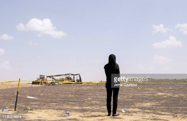A mourner believed to be an Ethiopian Airlines cabin crew member arrives to pay her respects at the crash site of Ethiopian Airlines Flight ET302 on...