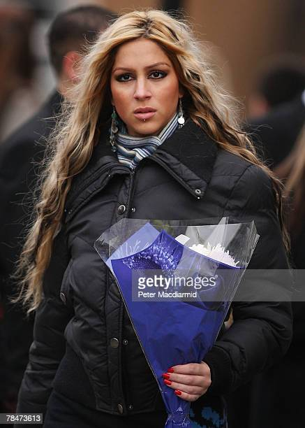 A mourner carries flowers to the funeral of Meredith Kercher on December 14 2007 at Croydon Parish Church South London Three people are being held by...