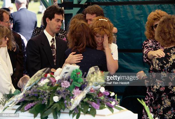 A mourner comforts Edye Smith mother of Chase and Colton Smith at the boys' funeral Chase and Colton were killed in the Oklahoma City bombing On...