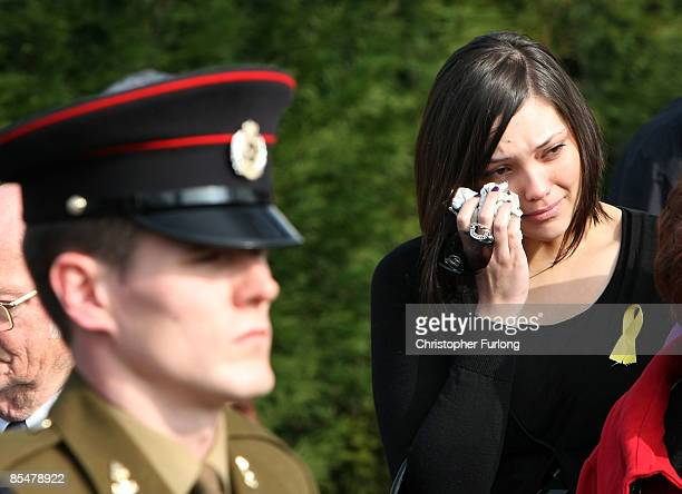 A mourner cries as the funeral cortege of Sapper Mark Quinsey who was murdered in Northern Ireland arrives at Immanuel Church in Highters Heath on...