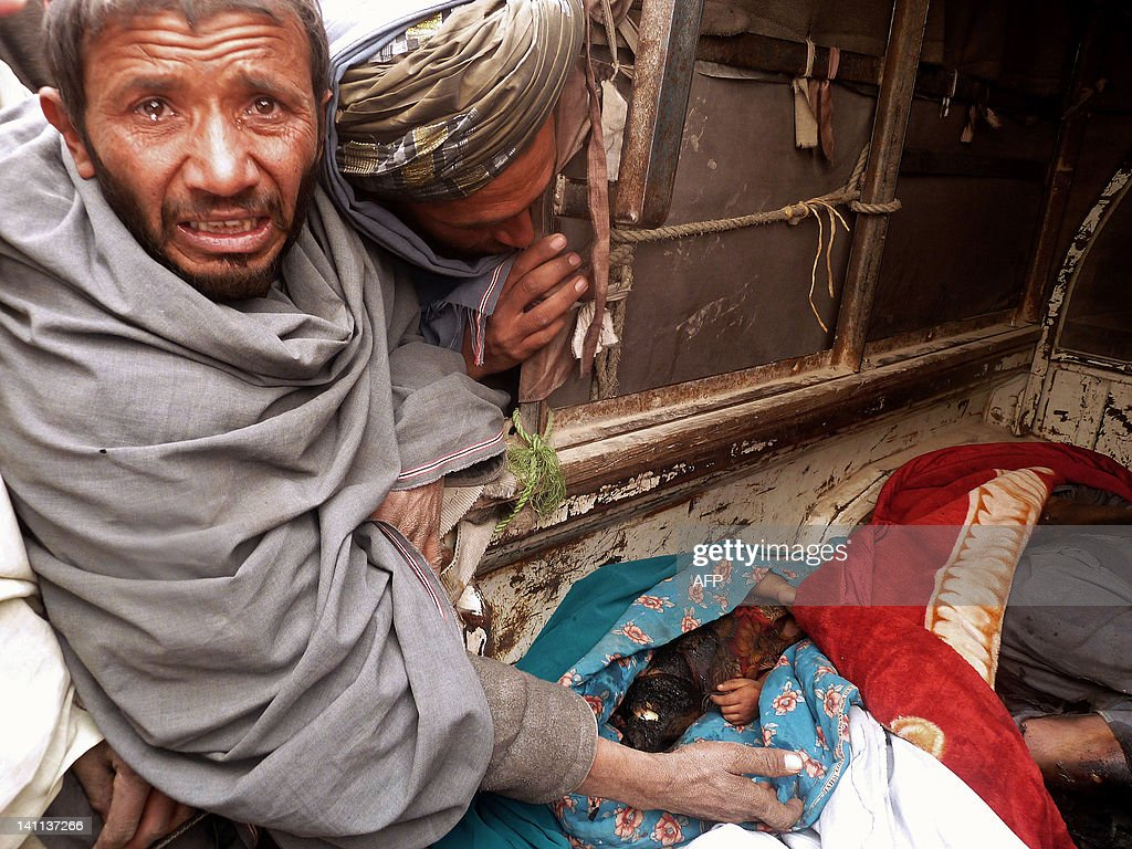 A mourner cries over the bodies of Afgha : News Photo
