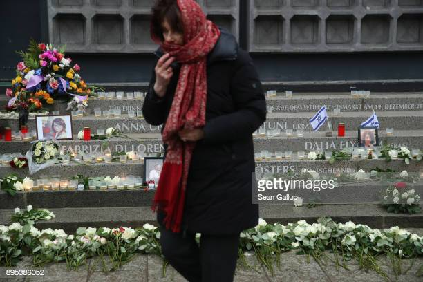 A mourner departs after laying a candle at a memorial to victims following its inauguration at the site of the 2016 Christmas market terror attack at...