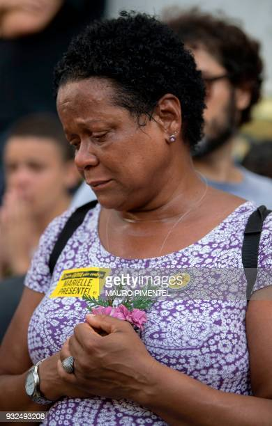 A mourner expresses her grief during the funeral of slain Brazilian councilwoman and activist Marielle Franco outside Rio de Janeiro's Municipal...