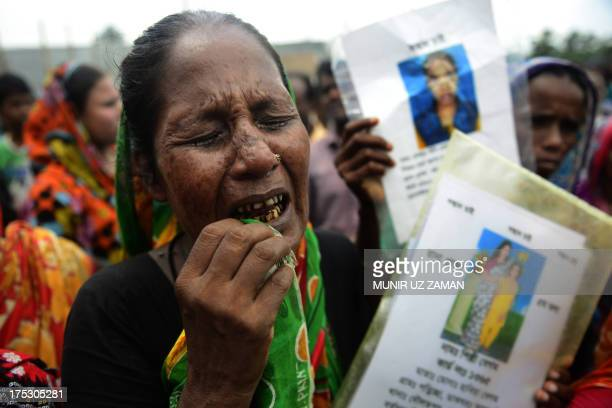 Mourner grieves for her missing relative, presumed dead following the April 24 Rana Plaza garment building collapse, during the one hundredth-day...