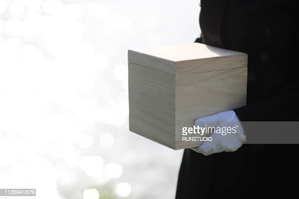 mourner holding urn - ash stock pictures, royalty-free photos & images