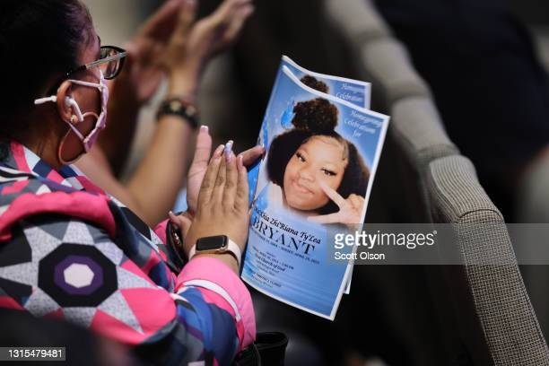 Mourner holds a funeral program during services for 16-year-old Ma'Khia Bryant at First Church of God on April 30, 2021 in Columbus, Ohio. Bryant was...