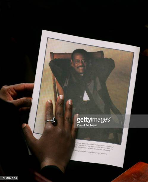 A mourner holds a program during the funeral services for lawyer Johnnie L Cochran Jr at the West Angeles Cathedral on April 6 2005 in Los Angeles...