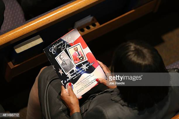 A mourner holds a program with photographs of retired Air Force Lt Col Eldridge Williams during his funeral at the Sweet Home Missionary Baptist...
