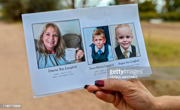 A mourner holds a rememberance card at the funeral ceremony for Dawna Ray Langford and her sons Trevor and Rogan who were among nine victims killed...