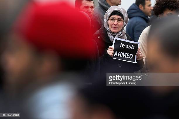 A mourner holds a sign saying 'Je suis Ahmed' during the funeral of murdered police officer Ahmed Merabet takes place at Bobigny muslim cemetery on...