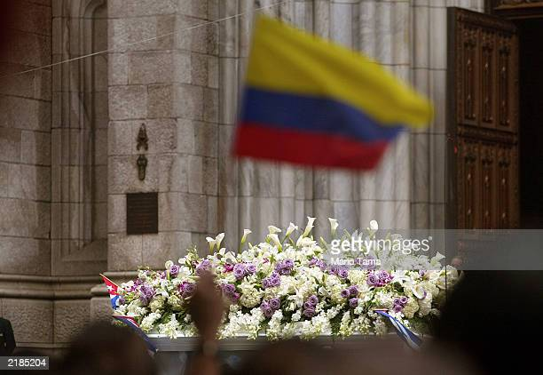A mourner holds an Ecuadorian flag before the flowerstrewn carriage carrying the casket of salsa star Celia Cruz July 22 2003 in New York City Cruz...