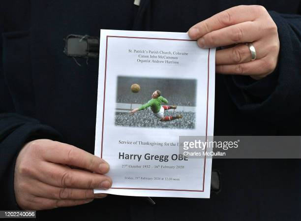 A mourner holds an order of service as the funeral of former Manchester United and Northern Ireland footballer Harry Gregg takes place on February 21...