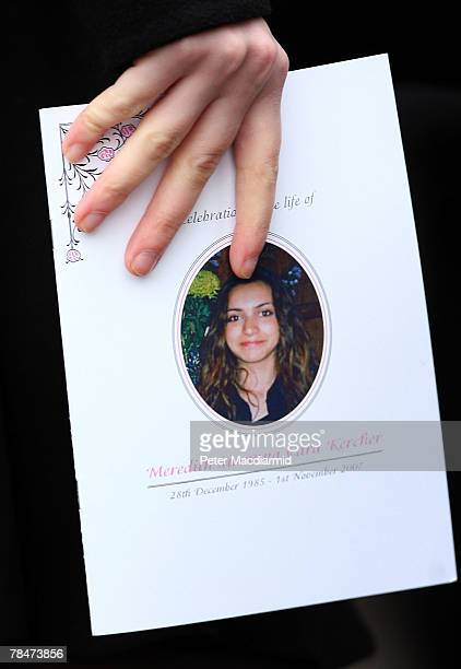 A mourner holds an order of service booklet at the funeral of Meredith Kercher on December 14 2007 at Croydon Parish Church South London Three people...